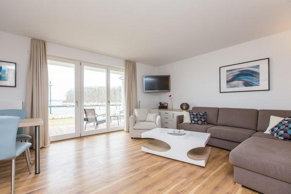 Wohnzimmer von Gemütliches Zweizimmer-Apartment  optional mit Bootsliegeplatz , Hund erlaubt (P7A2)