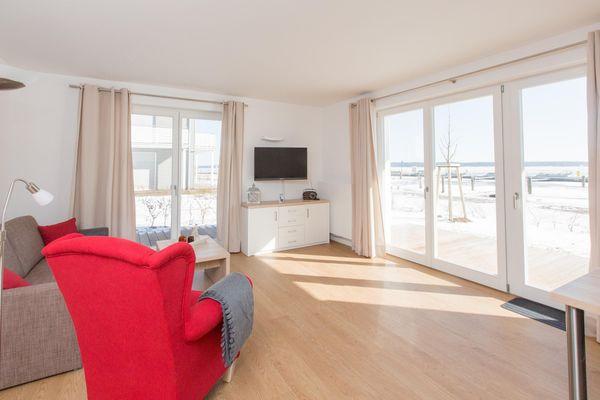 Wohnzimmer von *Leuchtturmblick*   Eck-Apartment 5 im Haus 6 mit 2 Terrassen, Hund erlaubt