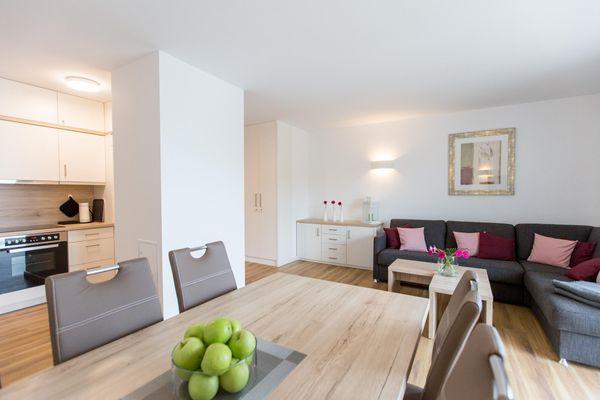 """Wohnzimmer von Maisonette-Apartment """"Hafenparadies"""" am Yachthafen , optional mit Bootsliegeplatz gegen Gebühr (Haus 6, A7)"""