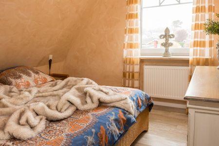 Altes Strandhus Casa Meeresrauschen Scharbeutz - OT Haffkrug - 1. Schlafzimmer Blick Garten