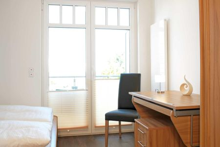 Doppelhäuser zum Reetmoor Haus Kirsten Schwarzer Busch - Schlafzimmer