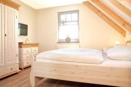 Doppelhäuser zum Reetmoor Haus Theresa Schwarzer Busch - Schlafzimmer