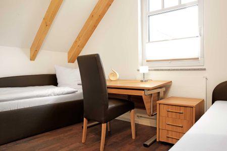 Doppelhäuser zum Reetmoor Haus Friederike Schwarzer Busch - Schlafzimmer