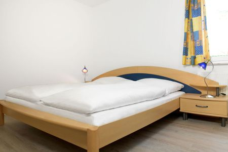 Residenz am Yachthafen Kugelfisch Kirchdorf - Schlafzimmer